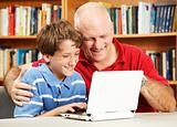 Father and Son Use Netbook Computer