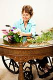 In Wheelchair Arranging Flowers