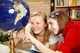 Library Teens Looking at Globe
