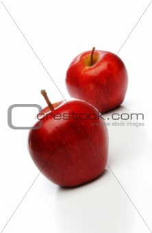 A pair of red apples