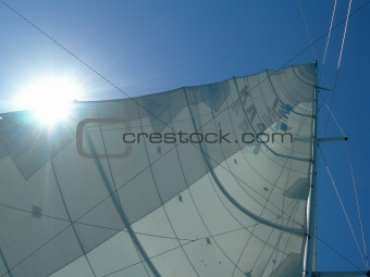 Sun glaring through a yacht's sail