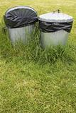 waste bins in grass