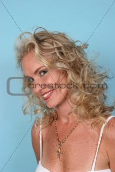 Blond model isolated on blue