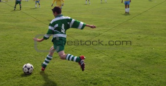 boy kicking ball