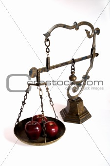 antique scale with apples