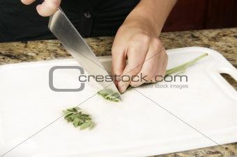 Cutting Sage in Kitchen