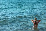 female torso on sea backgroung