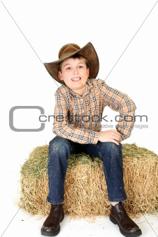 Boy chewing on a piece of straw