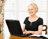 Mature woman with laptop.