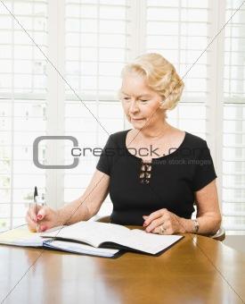 Mature woman with calendar.