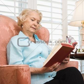 Mature woman reading.