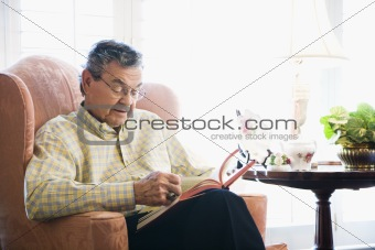 Mature man reading.