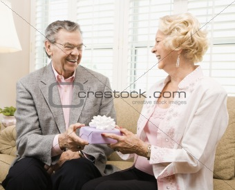 Mature couple with present.