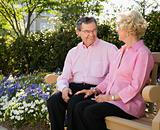 Mature couple on bench.