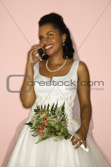 Bride talking on cellphone.
