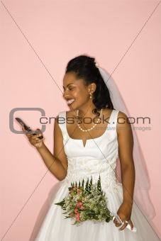 Bride looking at cellphone.