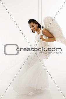 Angelic bride on swing.