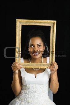 Bride holding frame.
