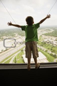 Boy at window.