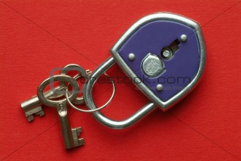 a blue padlock with keys on red