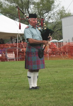A Scot Playing Pipes