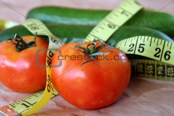Tomatoes  & cucumber with measuring tape