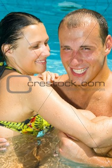 An attractive couple relaxing by the pool