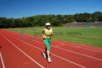 Attractive senior woman jogging
