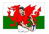 Rugby player passing the ball with Welsh flag