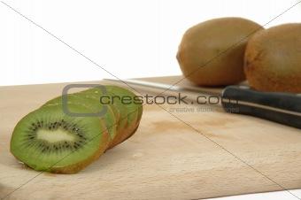 Kiwi slices with knife