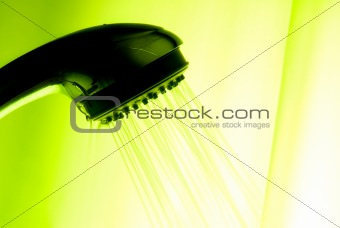 backlit showerhead with green background