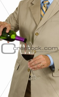 Man in suit pouring wine