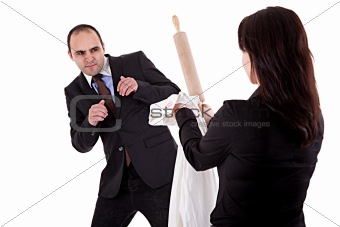 woman arguing with her husband, pointing to the rolling pin and a shirt with lipstick mark