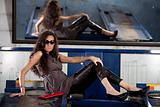 Fashion shot in auto repair shop.