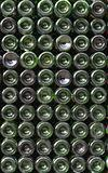Many green glass wine bottles at winestore