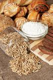 Variety of Bread, pastries, meal and pot with grains