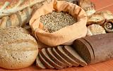 Variety of Bread, pastries, meal and bag with grains