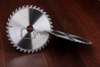 Circ saw blades on dark background