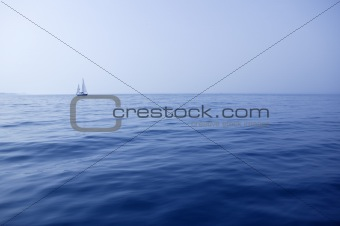 Blue sea with sailboat sailing the ocean surface summer