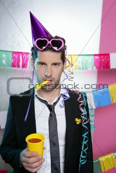 Blowing noisemaker suit party funny young man