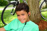 Teen smiling boy hearing music headphones