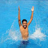 boy teenager splashing water open arms pool