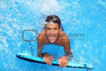 boy teenager surfboard splashing blue water