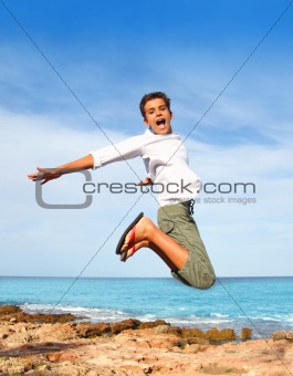 boy teenager high fly jump on beach blue sky
