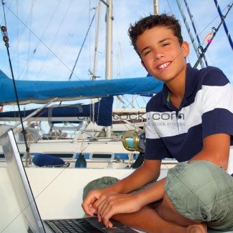 boy teen seat on boat marina laptop computer