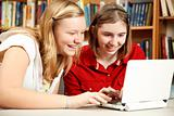 Teen Girls Use Computer in Library