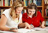 Teens Do Homework in Library