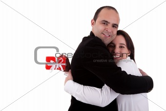 Man giving a gift to a woman, holding her