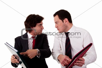 two businessmen discussing because of work, pointing to a document