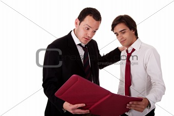 two businessmen talking about work, tired-looking, looking for a document